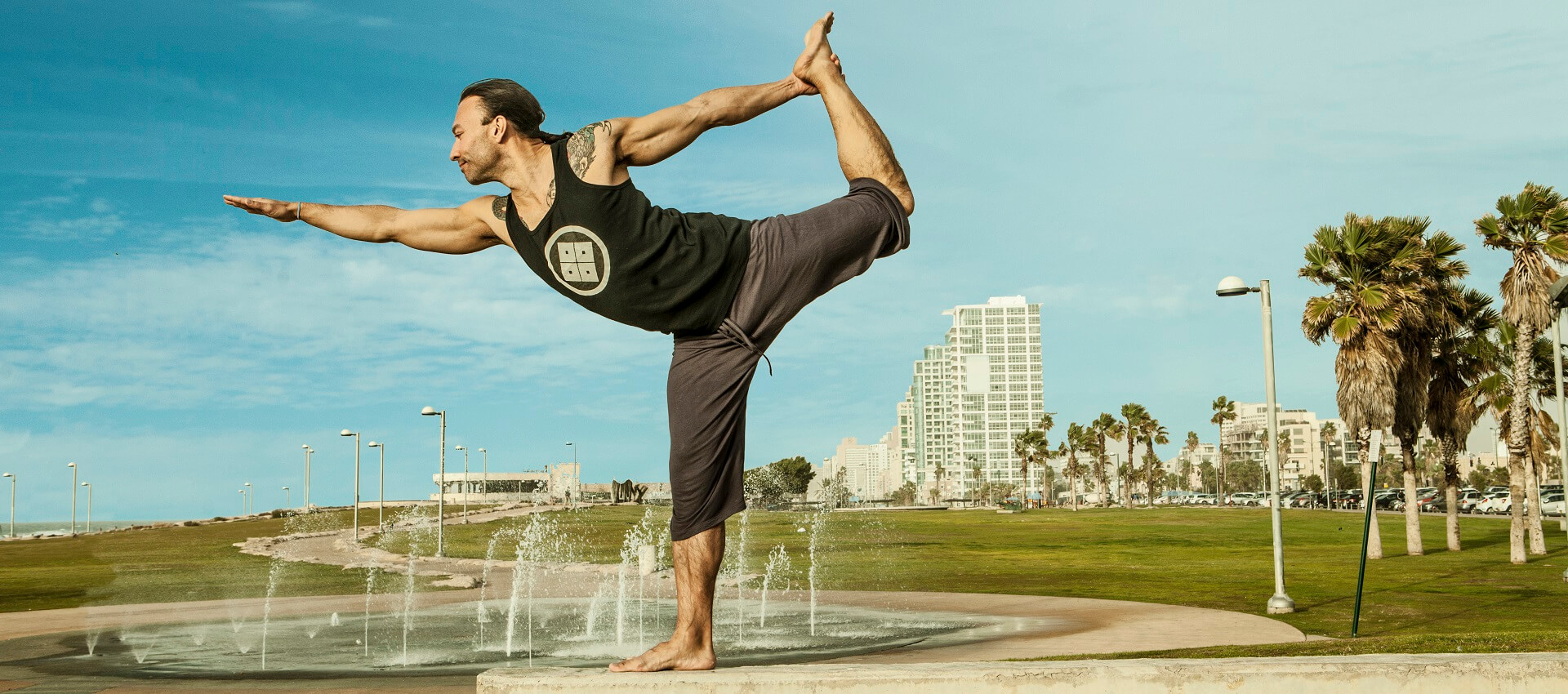Eddy Toyonaga vinyasa yoga in dancers pose in the Tel Aviv