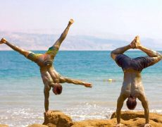 Eddy Toyonaga and Dylan Werner doing yoga at the Dead Sea