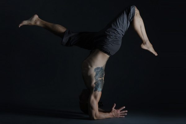Eddy Toyonaga in an inverted yoga pose