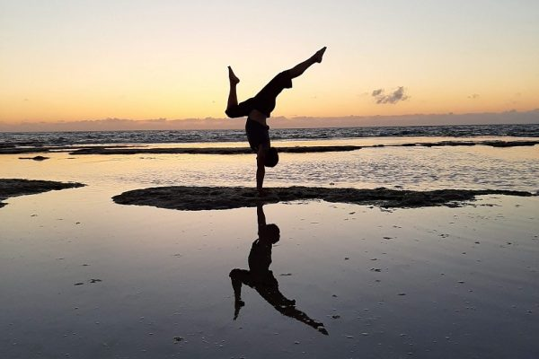 Eddy Toyonaga handstand on beach at sunset