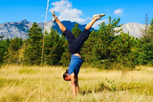 Eddy Toyonaga doing a handstand in the Rocky mountains